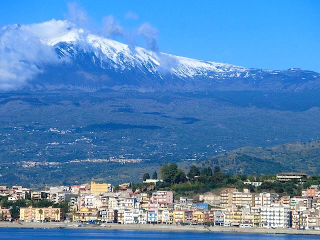 Mount Etna and Giardino Naxos taken from Quest by Corinne W.