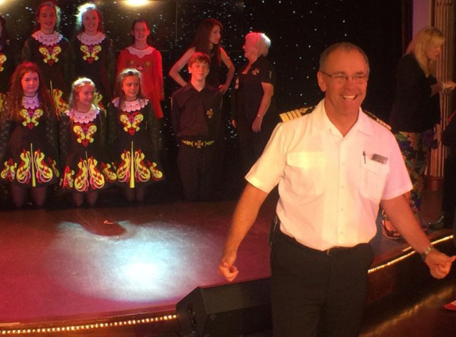 Azamara's Captain Jose enjoying an onboard performance.