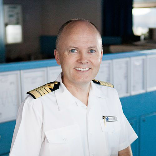 man wearing white captain suit