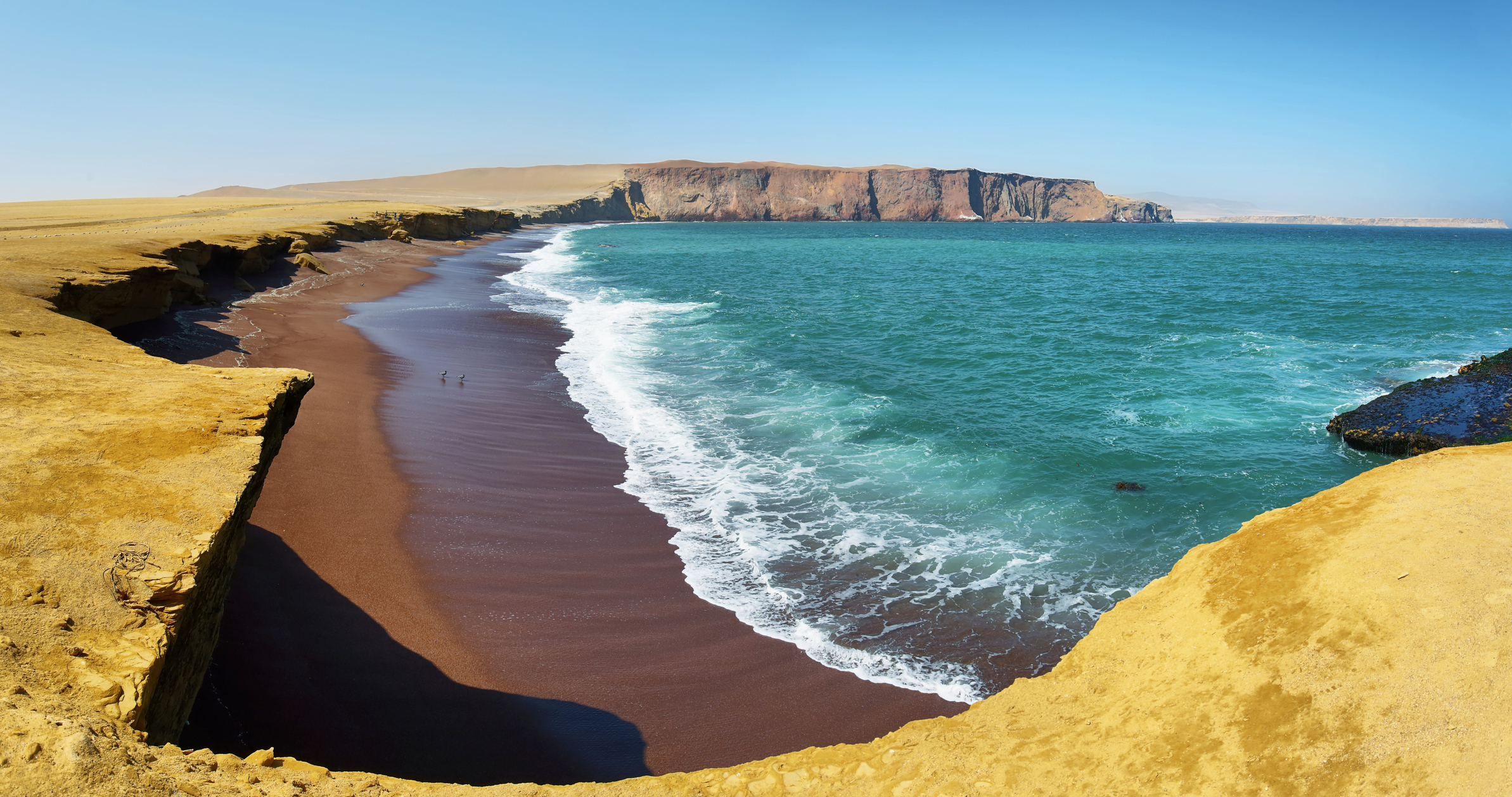 Waves crash upon the beach at Paracas National Reserve