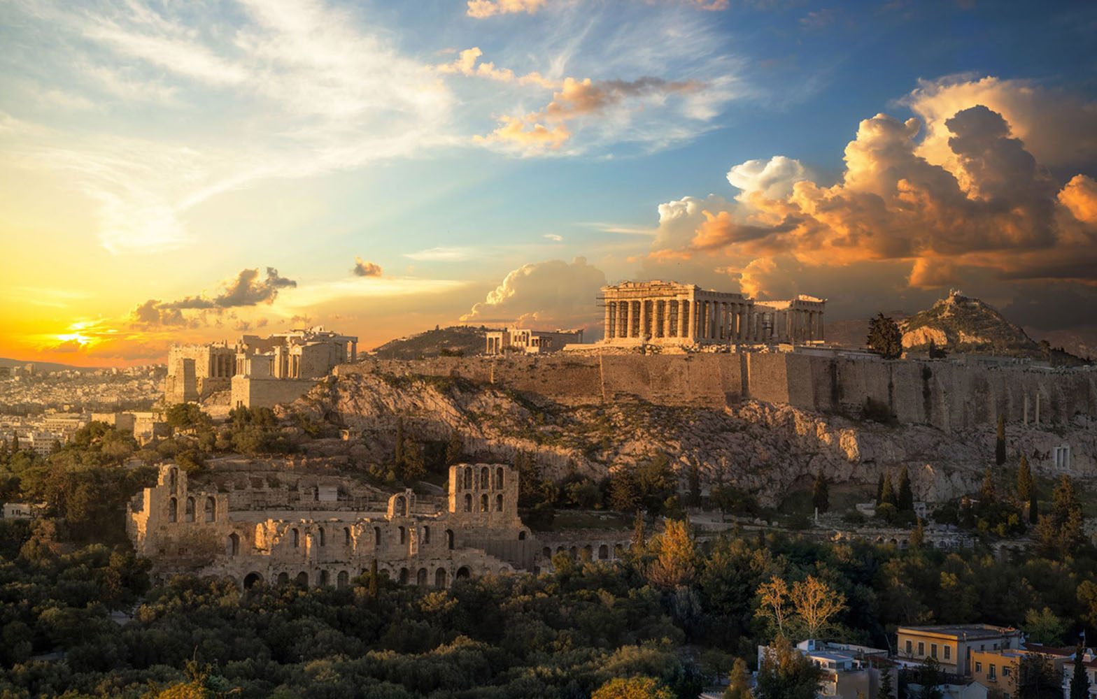 Acropolis of Athens at golden hour with a beautiful dramatic sky