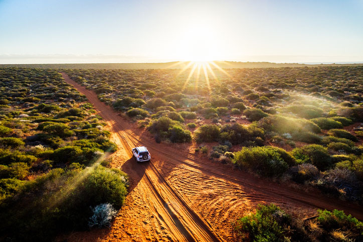 Driving in the outback of Australia at sunset