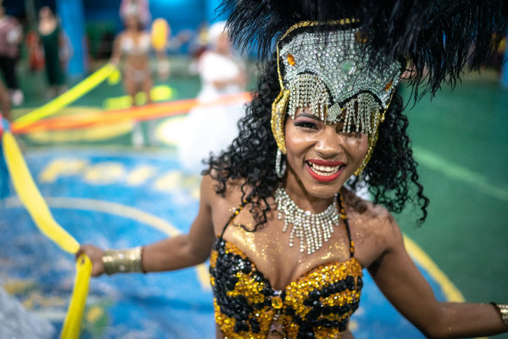 A woman celebrating and dancing at Brazilian carnival