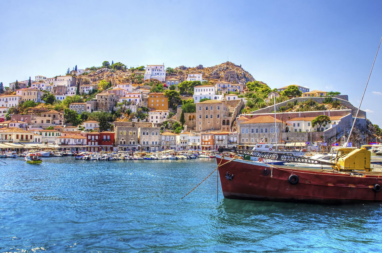 The Greek island of Hydra with a fishing boat in the water