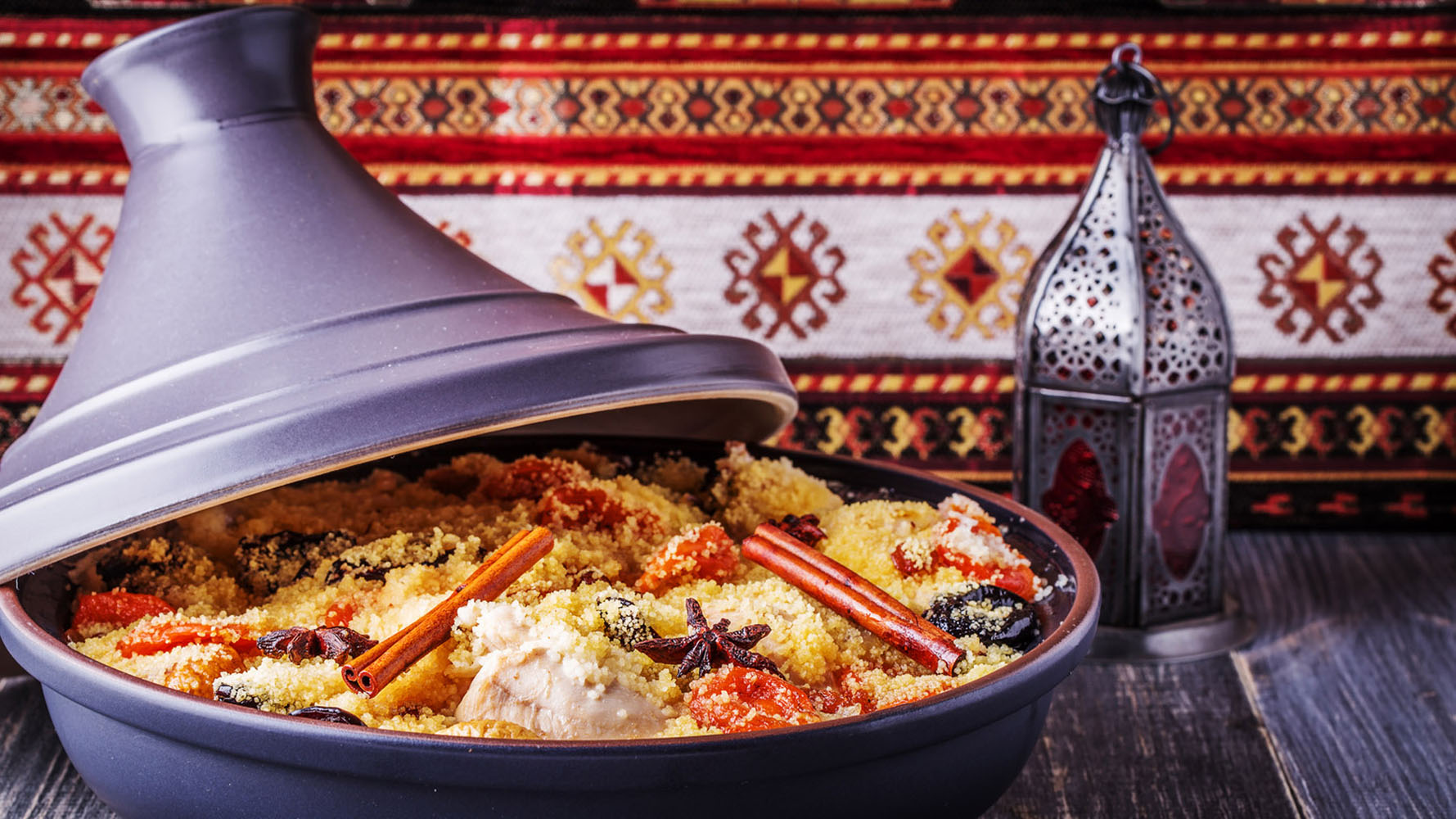 Traditional moroccan tajine of chicken with dried fruits and spice