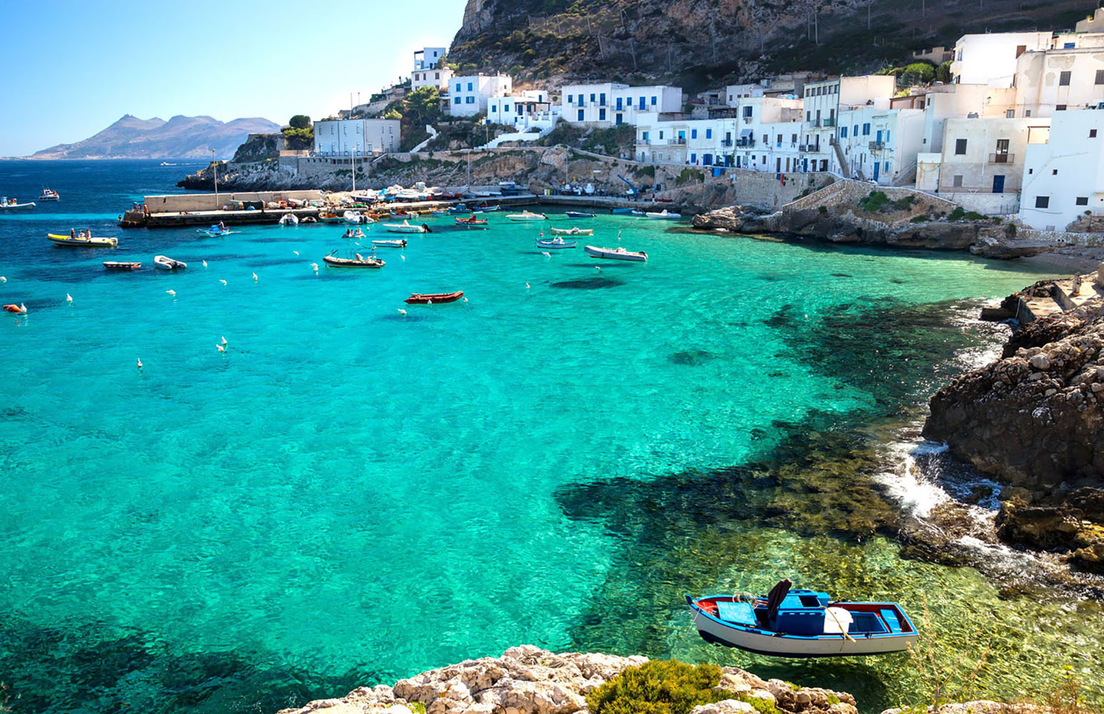 Levanzo Island with boats in the harbor.