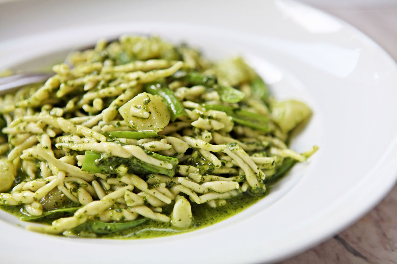 Basil pesto is served with Trofie pasta in Cinque Terre.