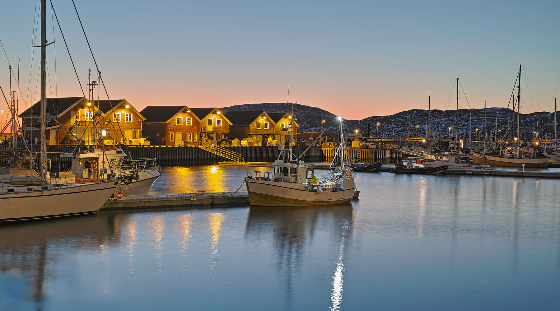 Small boats in the harbor of Bodo Norway at night