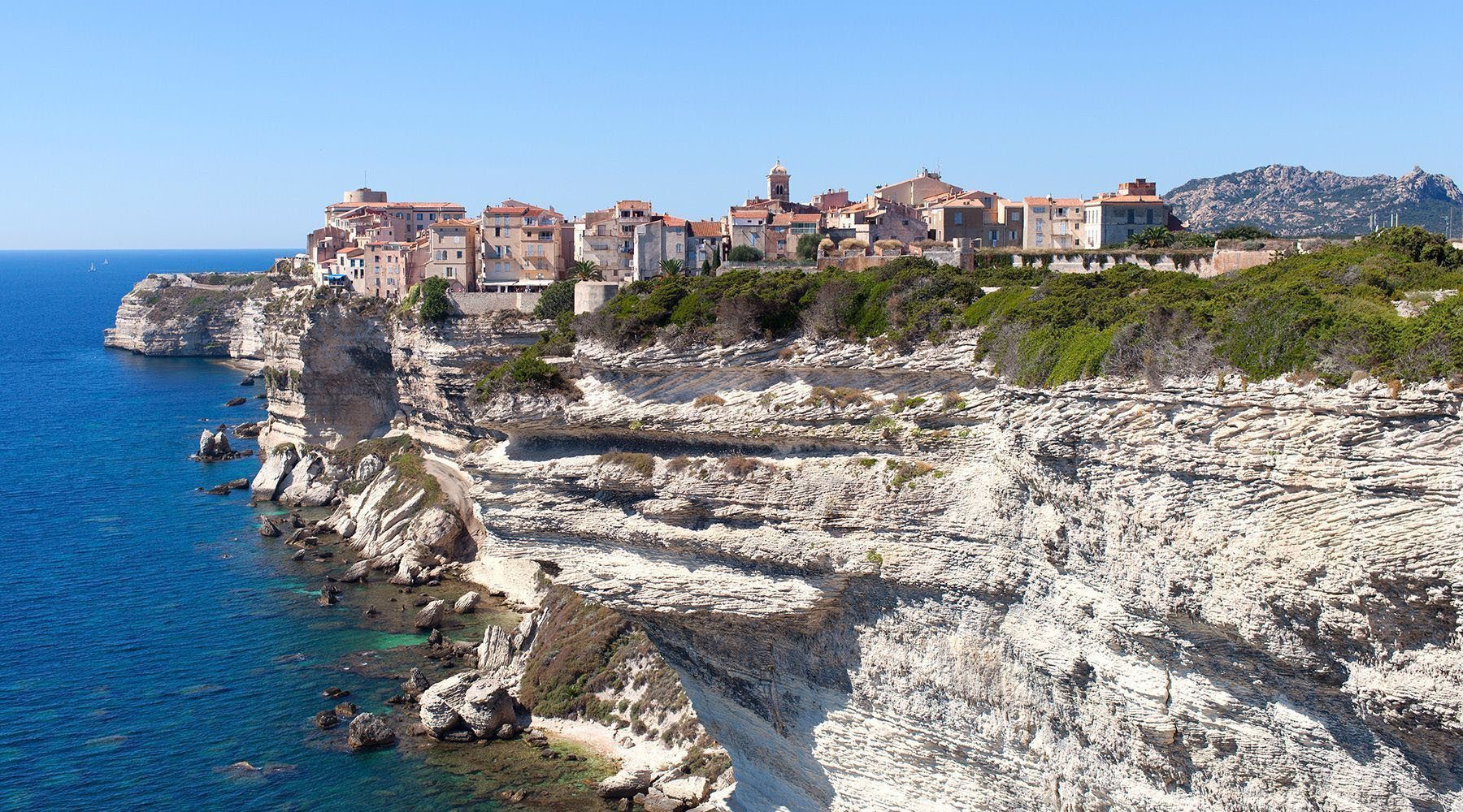Houses on a cliff of Bonifacio Corsica, France, overlooking the Mediterranean Sea
