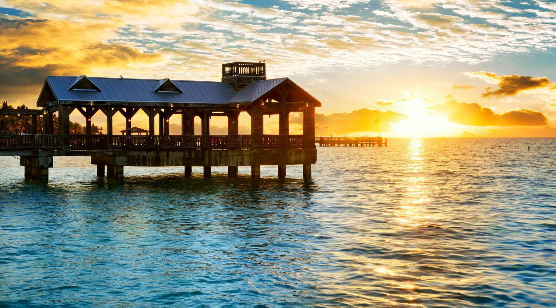 silhouette photo of cottage in key west florida on body of water