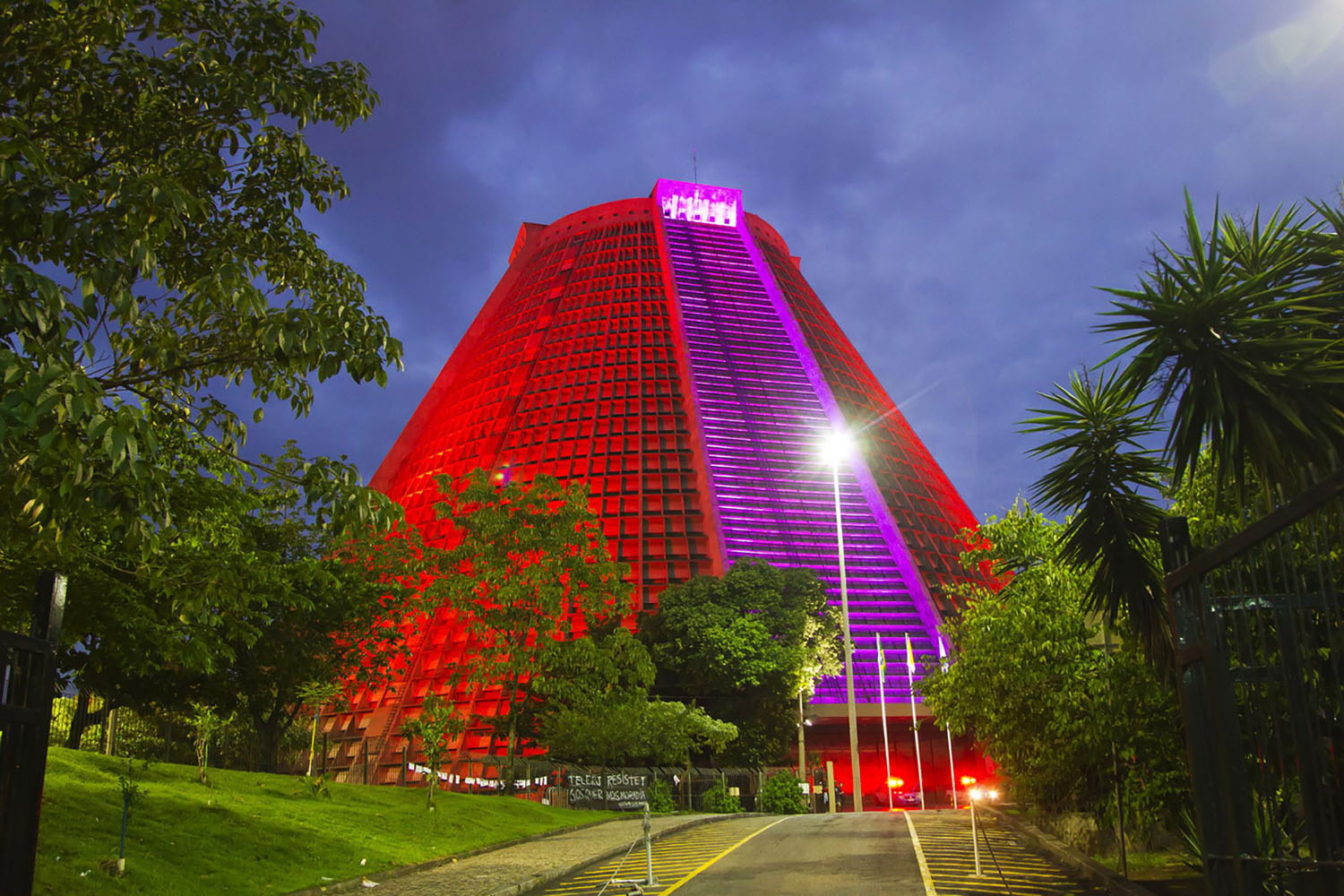 The Metropolitan Cathedral of Saint Sebastian in Rio de Janeiro colourfully illuminated in the evening