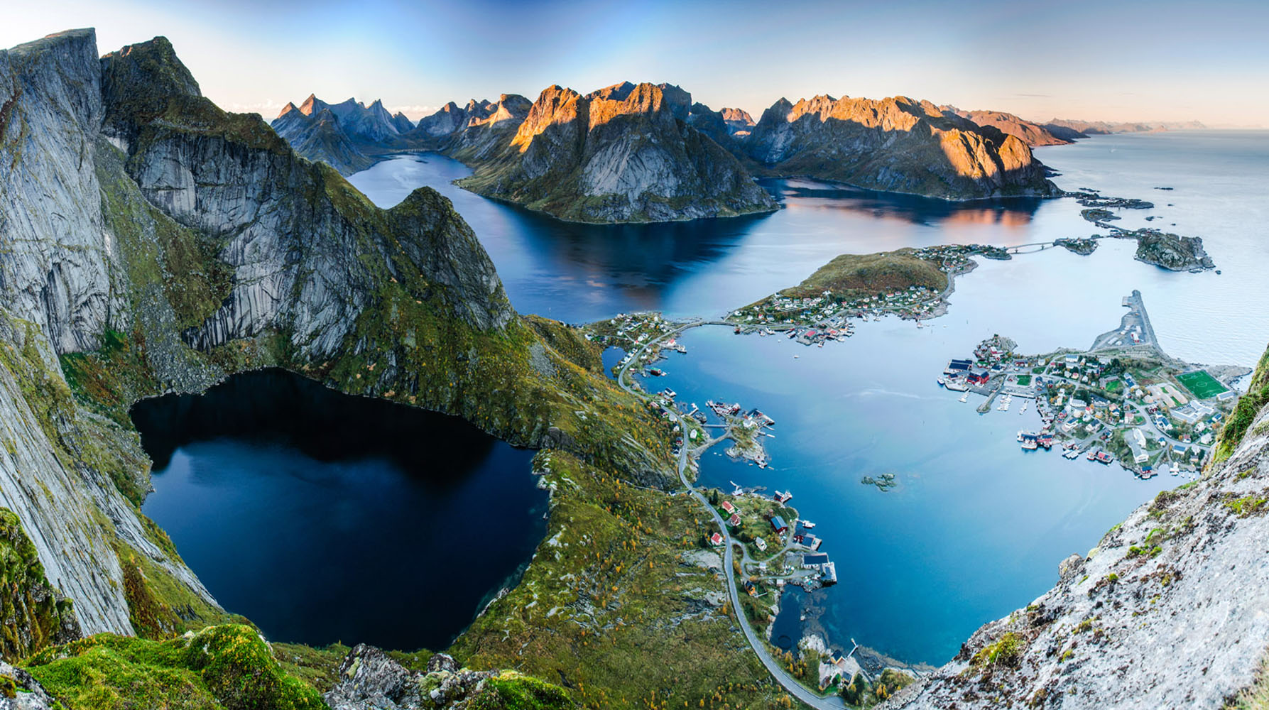 An overhead shot of mountains and lakes in the Norwegian Fjords.