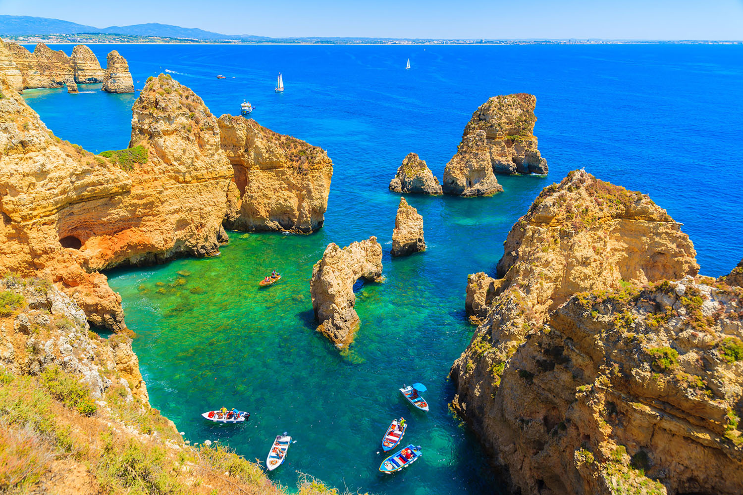 Portimao, Portugal is a destination that has it all: beautiful beaches, delectable cuisine, charming villages, and great local wine. Spend your day sunbathing, wine tasting, dolphin watching—whatever your heart desires.