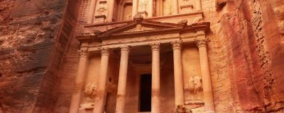 camels lying down in front of the treasury in petra jordan
