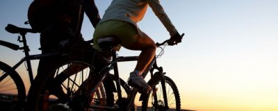 two cyclists watching the sunset